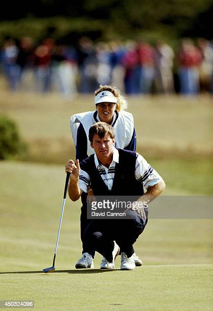 Nick Faldo of England with his caddie Fanny Sunesson of Sweden on the way to his win in the 119th Open Championship played on the Old Course at St...