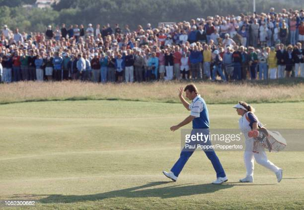 Nick Faldo of England with his caddy Fanny Sunesson walks up the 18th fairway enroute to victory on the final day of the British Open Golf...