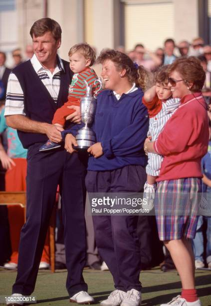 Nick Faldo of England with his family wife Gill daughter Natalie and son Mathew and his caddy Fanny Sunesson holding the Claret Jug following his...