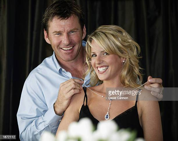Nick Faldo of England with his wife Valerie as she models the $AUS15000000 diamond and sapphire necklace that is a prize for a hole in one scored by...