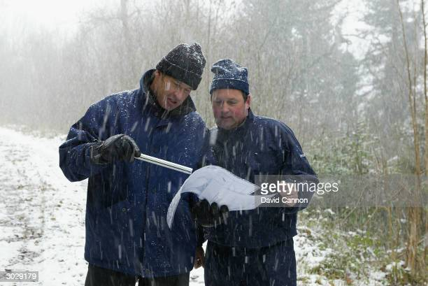 Nick Faldo of England with the owner of the property Jim Treacy in a snow storm working on the back nine during his site visit to his proposed new...