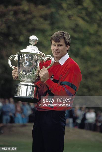 Nick Faldo of Great Britain holds the trophy after winning the Suntory World Match Play Championship at Wentworth Golf Club on 15th October 1989