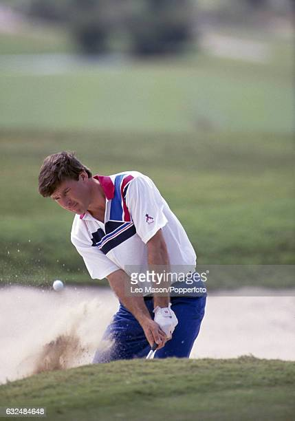 Nick Faldo of Great Britain playing out of a bunker during the Desert Classic at the Emirates Golf Club in Dubai circa February 1990