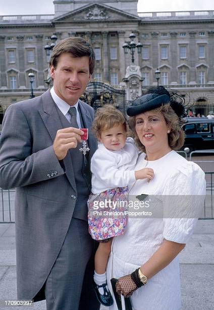 Nick Faldo of Great Britain poses with his wife Gill and daughter Natalie outside Buckingham Palace after receiving his MBE circa August 1988