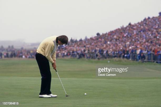 Nick Faldo of Great Britain watches the golf ball to the hole following his putt on the 18th green to win the 116th Open Championship golf tournament...