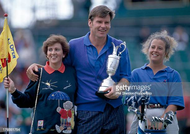 Nick Faldo of Great Britain with his wife Gill and his caddie Fanny Sunesson and the trophy after winning the British Open Golf Championship by one...
