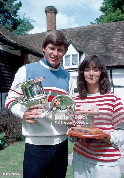 Nick Faldo of Great Britain with his wife Melanie holding the trophies for his three consescutive Tour victories at their home in 1983