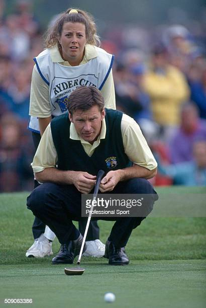Nick Faldo of the European Team and his caddie Fanny Sunesson in action during the Ryder Cup Golf Competition held at The Belfry Golf Club near...