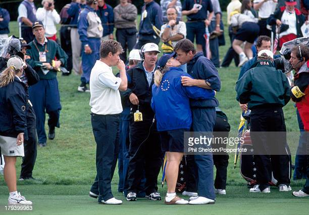 Nick Faldo of the European team kisses Brenna Cepelak a college golfer with whom he had a relationship between his second and third wives during the...