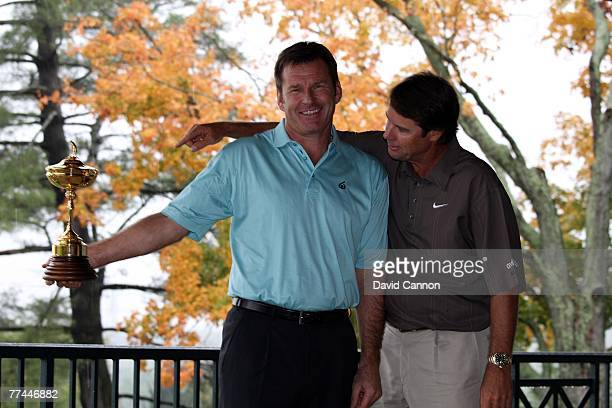 Nick Faldo the European Captain tries to keep the trophy from Paul Azinger the USA captain during the photoshoot as a preview for the 2008 Ryder Cup...