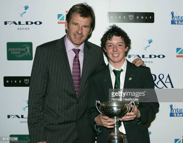 Nick Faldo with U15 boys winner Rory McIlroy pose during the 2004 Faldo Series Final held at Burhill Golf Club on October 11 2004 in Hersham Surrey...