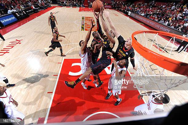 Nick Faust and Alex Len of the Maryland Terrapins reach for a rebound against the Delaware State Hornets at the Comcast Center on December 29 2012 in...