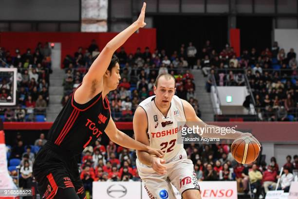 Nick Fazekas of the Kawasaki Brave Thunders handles the ball while under pressure from Joji Takeuchi of the Alvark Tokyo during the BLeague match...