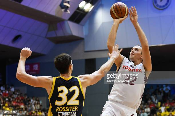 Nick Fazekas of the Kawasaki Brave Thunders shoots while under pressure from Ryan Rossiter of the Tochigi Brex during the BLeague Kanto Early Cup 3rd...