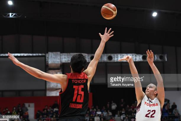 Nick Fazekas of the Kawasaki Brave Thunders shoots while under pressure from Joji Takeuchi of the Alvark Tokyo during the BLeague match between...
