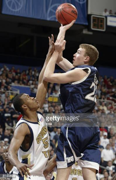 Nick Fazekas of the Nevada Wolfpack shoots over Anthony McHenry of the Georgia Tech Yellow Jackets during the third round game of the NCAA Division I...
