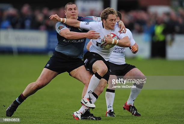 Nick Fenton Wells of Bedford tackles Alex Tait of Newcastle Falcons during the RFU Championship play off final, first leg match between Bedford and...