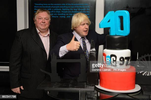 Nick Ferrari and Mayor of London Boris Johnson cut a birthday cake at the LBC 973 40th birthday party at Millbank Tower in Westminster central London