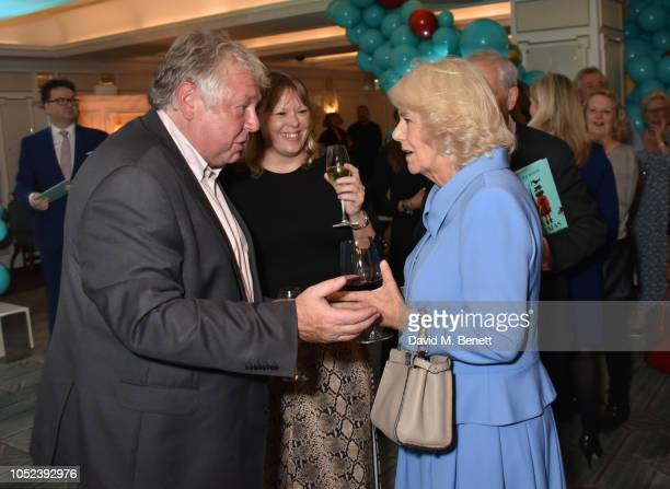 Nick Ferrari Sandra Phylis Conolly and Camilla Duchess of Cornwall attend the launch of the Fortnum Mason Christmas Other Winter Feasts cookbook by...