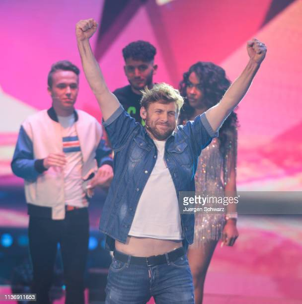 Nick Ferretti lifts his arms during the second event show of the tv competition Deutschland sucht den Superstar at Coloneum on April 13 2019 in...