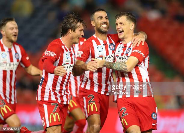 Nick Fitzgerald Emmanuel Muscat and Michael Jakobsen of Melbourne City celebrate a goal during the round nine ALeague match between the Newcastle...
