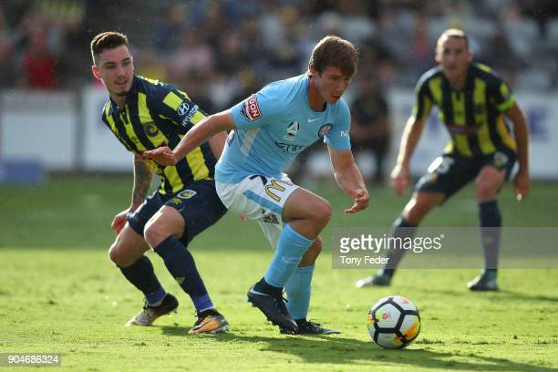 Nick Fitzgerald of City contests the ball with Storm Roux of the Mariners during the round 16 ALeague match between the Central Coast Mariners and...