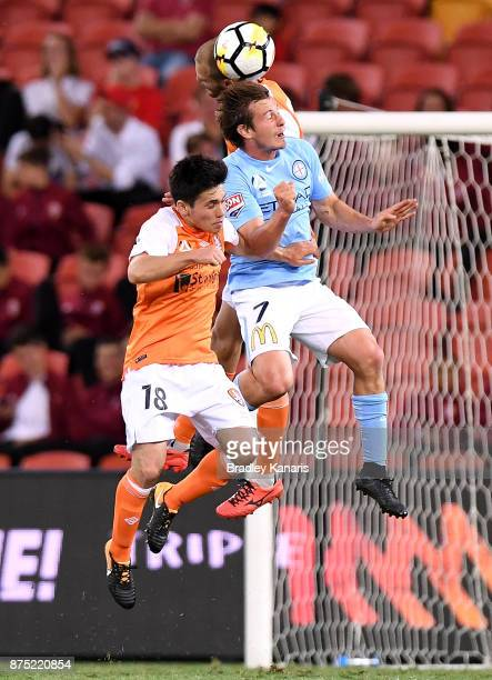 Nick Fitzgerald of Melbourne City and Joe Caletti of the Roar compete for the ball during the round seven ALeague match between Brisbane Roar and...