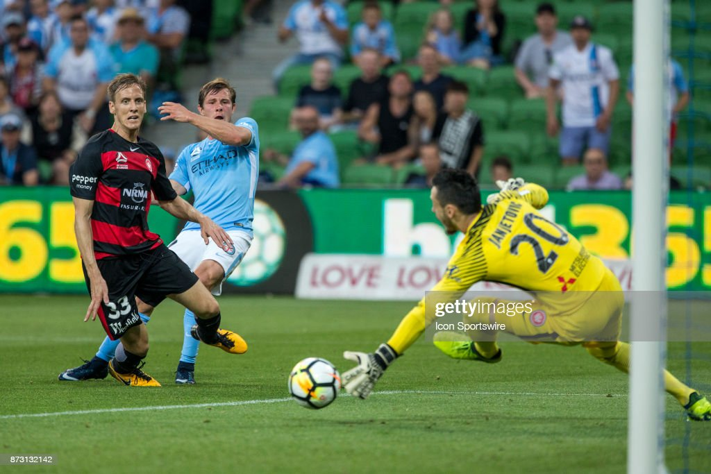 Nick Fitzgerald of Melbourne City and Michael Thwaite of the Western Sydney Wanderers watch on while Vedran Janjetovic of the Western Sydney Wanderers dives for the ball during Round 6 of the Hyundai A-League Series between Melbourne City and the Western Sydney Wanderers on November 11, 2017, at AAMI Park in Melbourne, Australia.