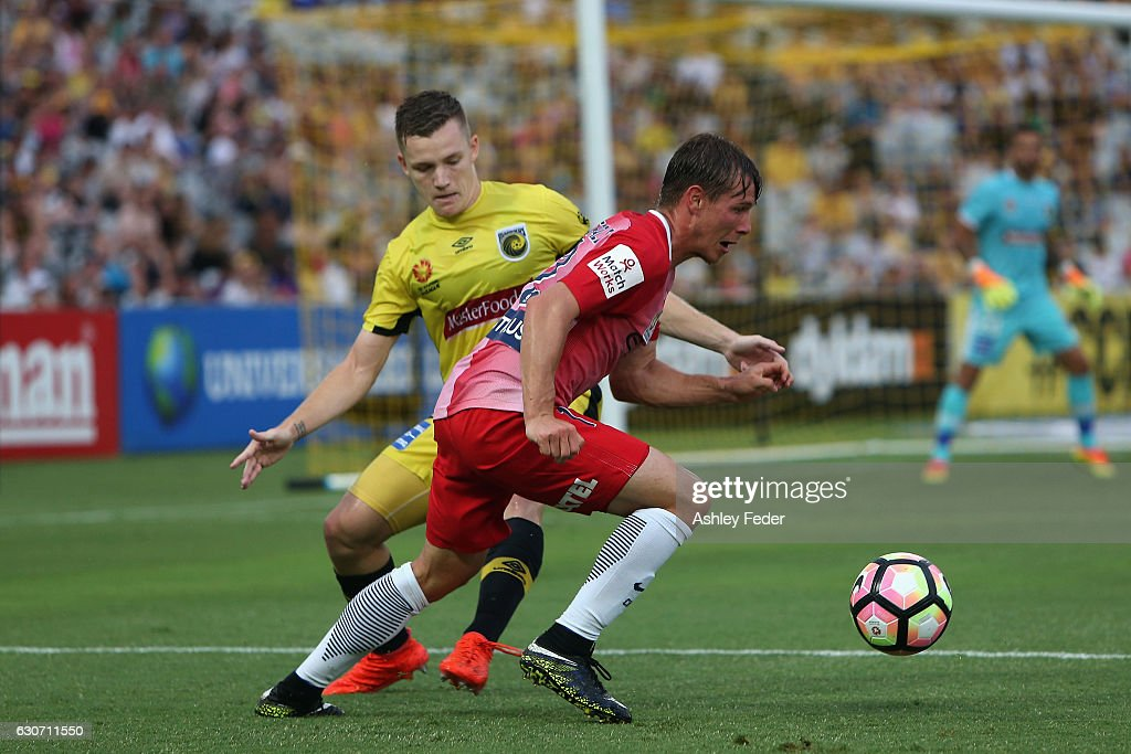 Nick Fitzgerald of Melbourne City is contested by Scott Galloway of the Mariners during the round 13 A-League match between the Central Coast Mariners and Melbourne City at Central Coast Stadium on December 31, 2016 in Gosford, Australia.