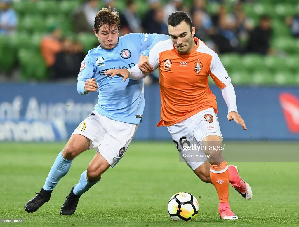 Nick Fitzgerald of the City and Nicholas D'Agostino of the Roar compete for the ball during the round one A-League match between Melbourne City FC and the Brisbane Roar at AAMI Park on October 6, 2017 in Melbourne, Australia.