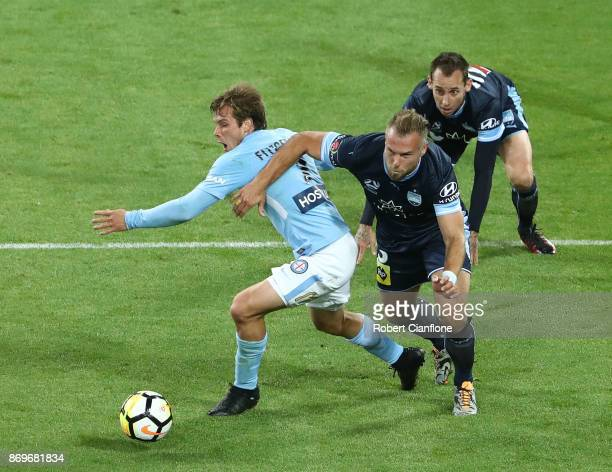 Nick Fitzgerald of the City is challenged by Jordy Buijs of Sydney FC during the round five ALeague match between Melbourne City FC and Sydney FC at...