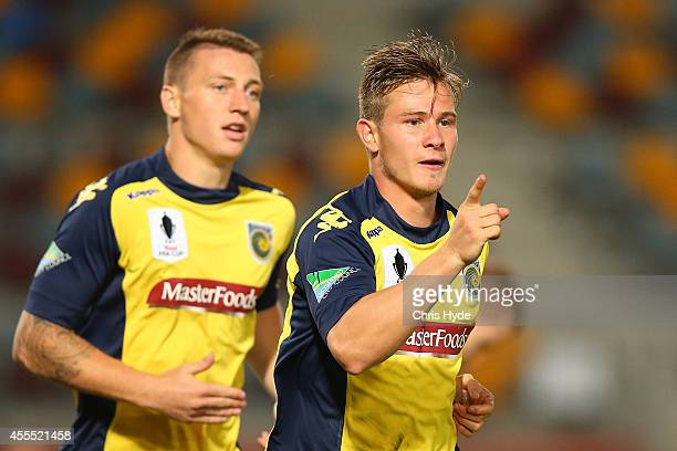 Nick Fitzgerald of the Mariners celebrates after scoring during the FFA Cup match between Olympic FC and the Central Coast Mariners at the Queensland...