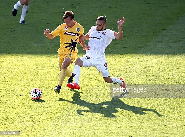 Nick Fitzgerald of the Mariners contests the ball with Jack Hingert of the Roar during the round 11 ALeague match between the Central Coast Mariners...