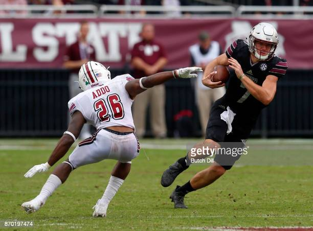 Nick Fitzgerald of the Mississippi State Bulldogs carries the ball as he gets around Jarell Addo of the Massachusetts Minutemen during the second...