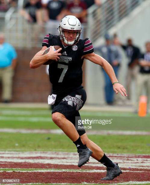 Nick Fitzgerald of the Mississippi State Bulldogs carries the ball against the Massachusetts Minutemen during the second half of an NCAA football...