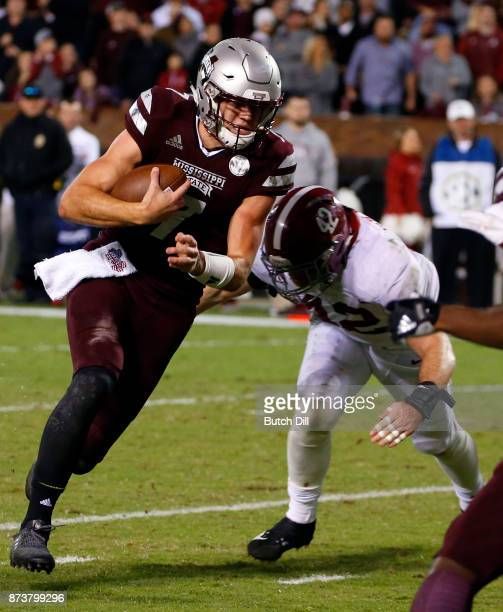 Nick Fitzgerald of the Mississippi State Bulldogs carries the ball around Keith Holcombe of the Alabama Crimson Tide and scores a touchdown during...