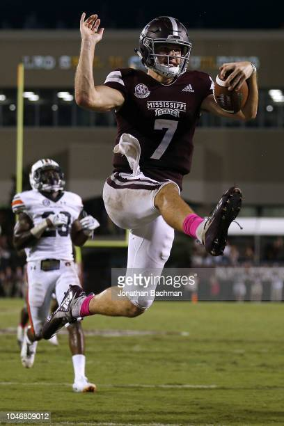 Nick Fitzgerald of the Mississippi State Bulldogs leaps to score a touchdown during the second half against the Auburn Tigers at Davis Wade Stadium...