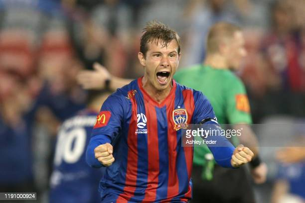 Nick Fitzgerald of the Newcastle Jets celebrates a goal with team mates during the round eight A-League match between the Newcastle Jets and the...