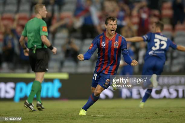 Nick Fitzgerald of the Newcastle Jets celebrates his goal with team mates during the round eight A-League match between the Newcastle Jets and the...