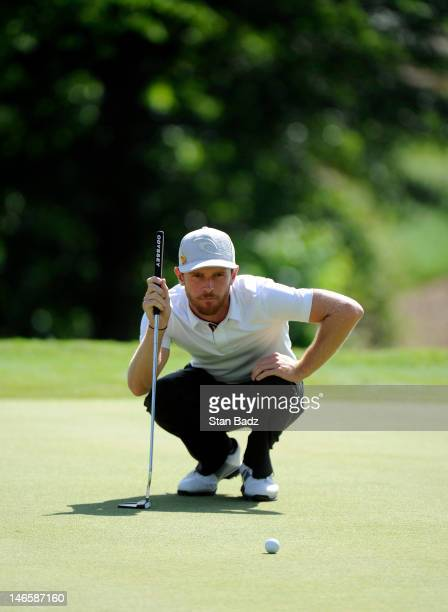 Nick Flanagan from Australia checks his putt on the 18th hole during the second playoff hole of the final round of the BMW Charity ProAm presented by...