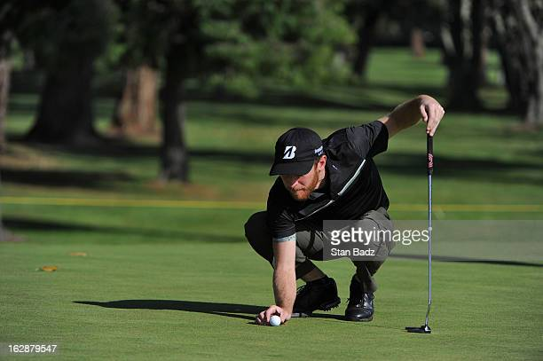 Nick Flanagan of Australia lines his ball on the 16th green during the first round of the Colombia Championship at Country Club de Bogota on February...