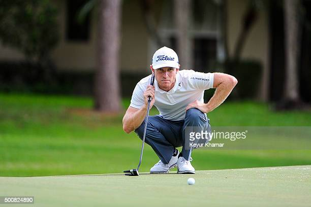 Nick Flanagan of Australia reads his putt on the ninth hole green on the Fazio Course during the first round of Webcom Tour QSchool at PGA National...