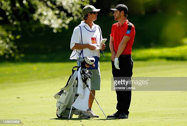Nick Flanagan of Australia talks with his caddie on the fairway of the 12th hole during the second round of the Wells Fargo Championship at the Quail...