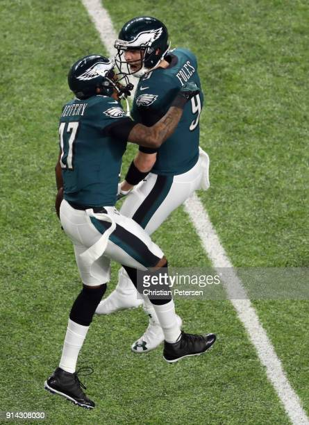 Nick Foles and Alshon Jeffery of the Philadelphia Eagles celebrate a 34yard touchdown pass against the New England Patriots in the first quarter of...