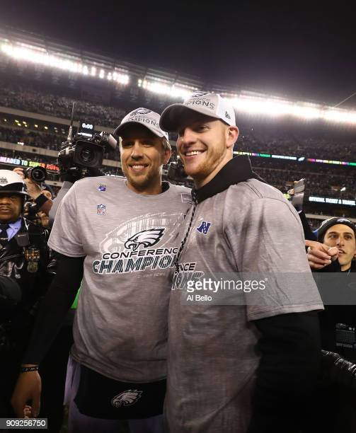 Nick Foles and Carson Wentz of the Philadelphia Eagles stand together after their 387 win against the Minnesota Vikings during their NFC Championship...