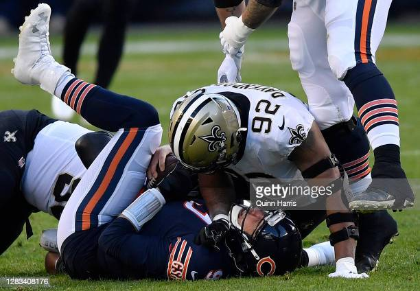 Nick Foles of the Chicago Bears after a sack by Marcus Davenport of the New Orleans Saints in the first half at Soldier Field on November 01, 2020 in...
