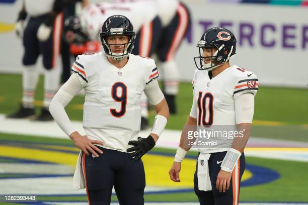 Nick Foles of the Chicago Bears and Mitchell Trubisky chat during warmup prior to the start of the game against the Los Angeles Rams at SoFi Stadium...
