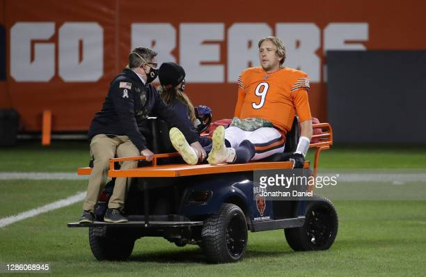 Nick Foles of the Chicago Bears is carted off of the field after being hit by Ifeadi Odenigbo of the Minnesota Vikings during the fourth quarter of...