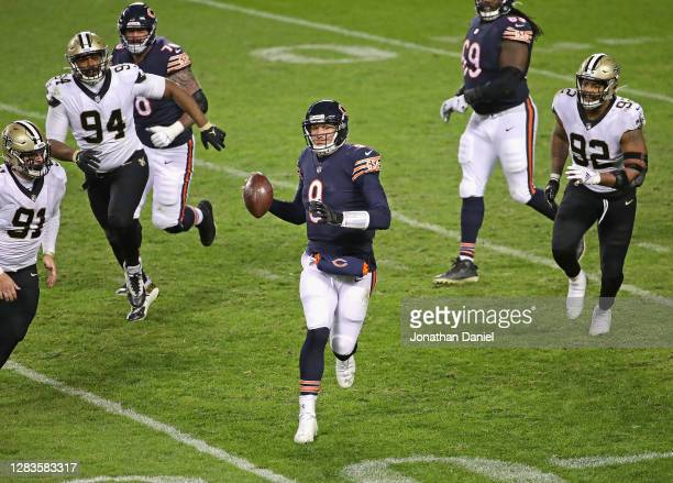 Nick Foles of the Chicago Bears is chased from the pocket by Trey Hendrickson, Cameron Jordan and Marcus Davenport of the New Orleans Saints at...