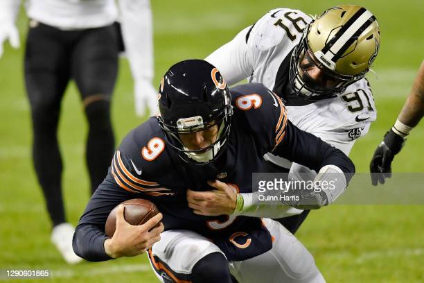 Nick Foles of the Chicago Bears is tackled by defensive end Trey Hendrickson of the New Orleans Saints at Soldier Field on November 01, 2020 in...